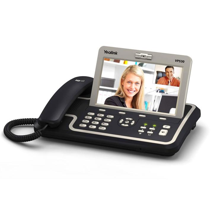 """Yealink VP-530Display LCD TFT digital de 7"""" con pantalla táctil (800x480 píxeles )Cámara ajustable CMOS con 2 megapixels4 cuentas SIP configurables27 teclas 6 teclas de función: Mute / Cámara / Agenda / Transferir llamada / Rellamada / Manos LibresMemoria interna 128MB y 256MB DDR22 puertos RJ-451 puerto USB2.01 slot para tarjetas SDConexión para auricular de 2,5mmDetección de Voz (VAD) y supresión de silencio"""